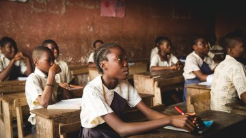 Children in a class room somewhere in Africa, where there won't be any snow